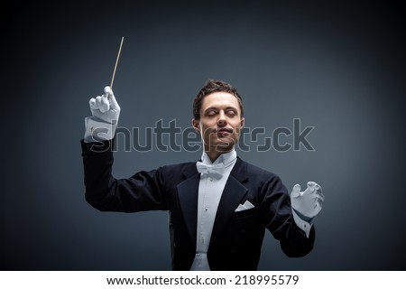 Conductor on a dark background - stock photo