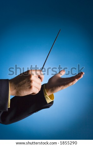 conductor's hands on blue background - stock photo