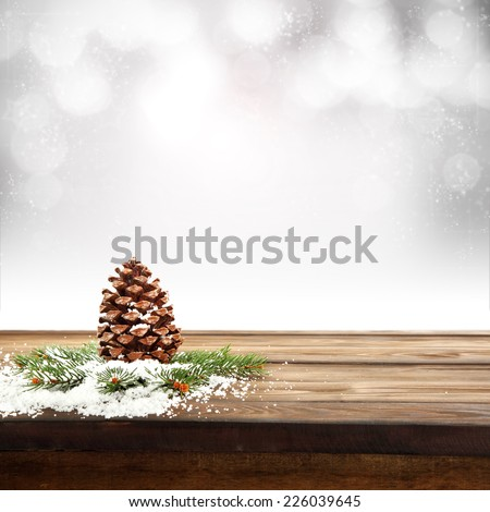 cone table and snow on tree  - stock photo