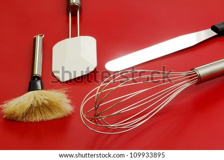 confectioner utensils over red background - stock photo