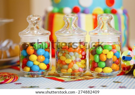 Confectionery Sweet Shop Candies displayed in glass jars and vases. Square.