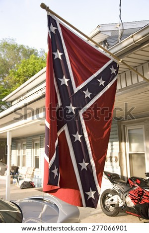 Confederate flag displayed on the porch of a Lancaster County home in Pennsylvania - stock photo