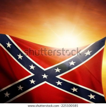 Confederate flag in front of bright sky - stock photo