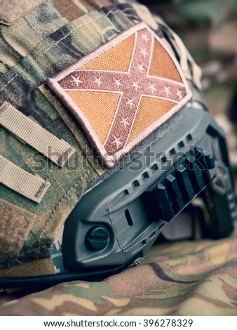 Confederate Flag patch on a modern combat helmet, shallow depth of field - stock photo