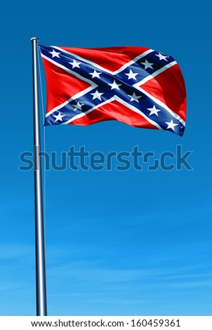 Confederate flag waving on the wind - stock photo