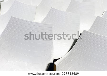 Conference chairs in business room, rows of white plastic comfortable seats in empty corporate presentation meeting office, detail, selective focus  - stock photo