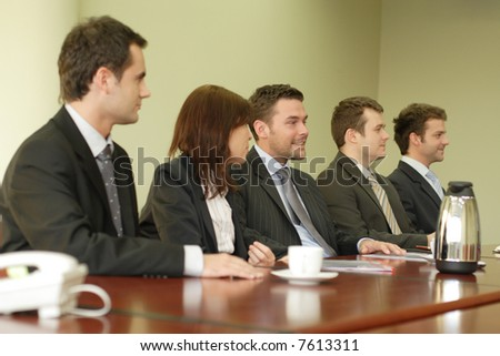 Conference, group of 5 business people sitting at the big table - stock photo