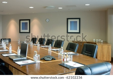 conference hall Interior with table, raw of chairs and blocknotes - stock photo