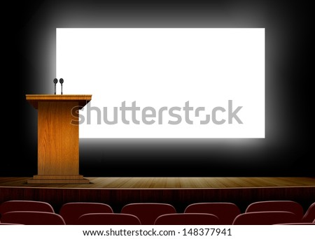 Conference hall with podium and presentation  screens  - stock photo