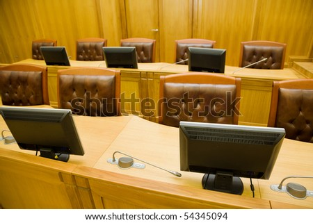 Conference halls with magnificent leather armchairs and wooden tables with microphones and monitors, Foreshortening from above