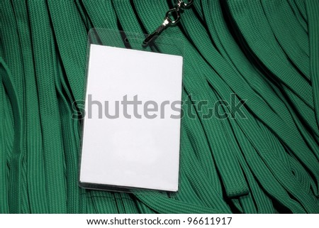 Conference ID card on green lanyards background suggesting green or environmental conference. - stock photo