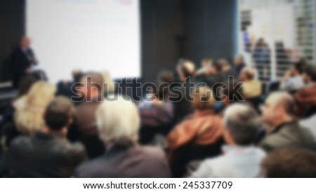 Conference meeting background. Intentionally blurred post production. - stock photo