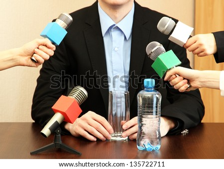 Conference meeting microphone with businessman or politician - stock photo