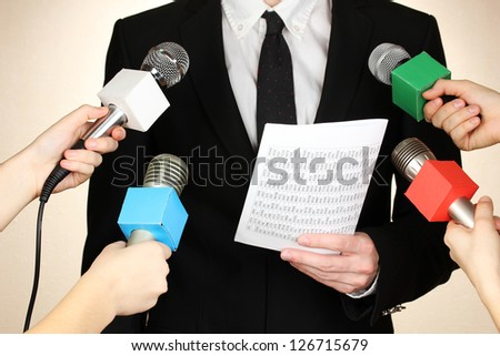 Conference meeting microphones and businessman - stock photo