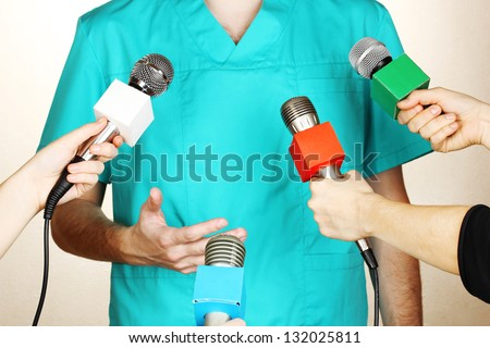 Conference meeting microphones and doctor - stock photo