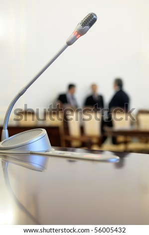 Conference room microphone. - stock photo