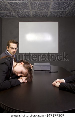 Conference room with blank screen for logo space - stock photo
