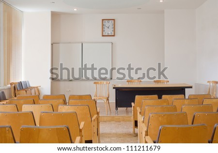 Conference room with chairs, blackboard