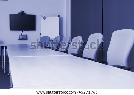 Conference room with video conference equipment and laptop - stock photo