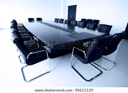 Conference table and chairs in meeting room - stock photo