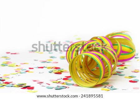 Confetti and colorful streamers on white background - stock photo