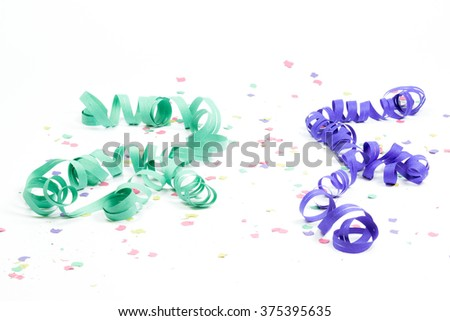 confetti and streamers on white background - stock photo