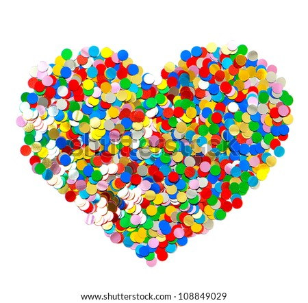 confetti in heart shape. colorful background red, blue, green, yellow