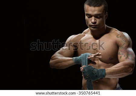 Confidence and tranquility. Studio shot of an African male boxer doing bandages - stock photo