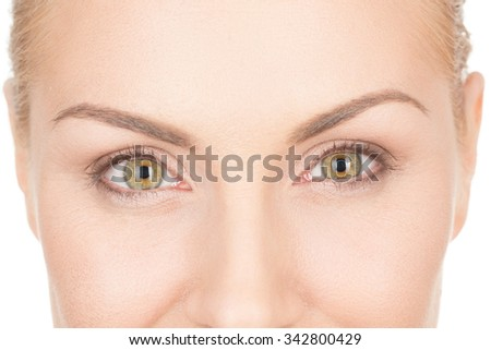 Confidence in her eyes. Closeup cropped shot of a woman looking to the camera smiling with her eyes - stock photo