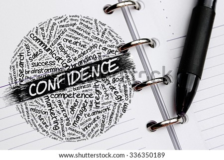 CONFIDENCE word concept written on notebook - stock photo