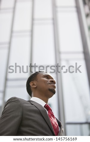 Confident African American businessman looking away - stock photo