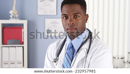 Confident African American doctor in clinic - stock photo