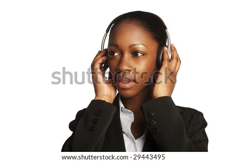 confident african business woman standing upwearing elegant clothes and headphones - stock photo