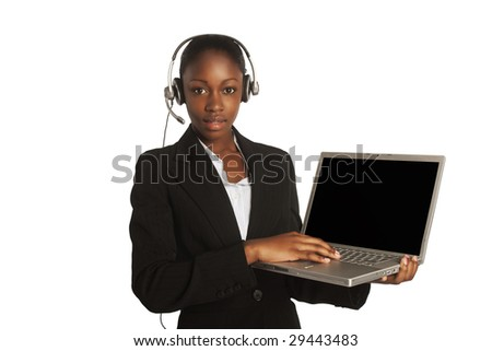 confident african business woman standing upwearing elegant clothes and headphones with the laptop - stock photo