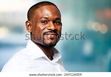 Confident african businessman in his office - stock photo