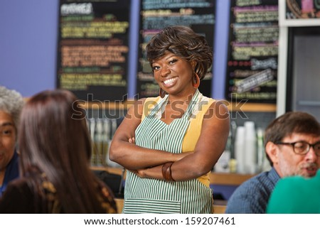 Confident African woman working at a coffee house