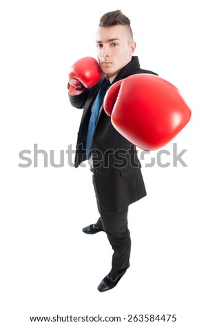 Confident and competitive business man punching the camera with red boxing gloves - stock photo