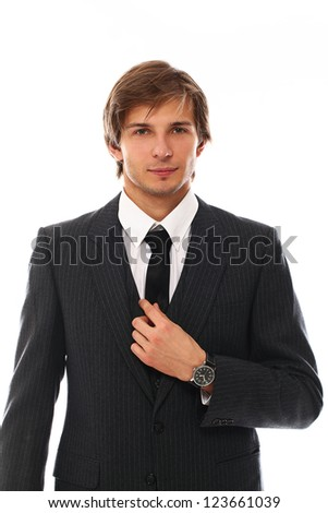 Confident and handsome man in suit portrait over a white background - stock photo