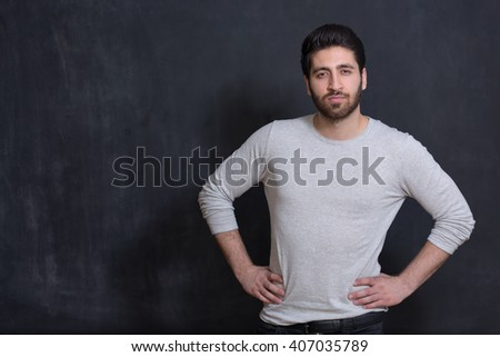 Confident and well-dressed. Handsome young man in smart casual wear looking at camera while standing against grey background