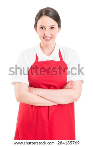 Confident and young female supermarket employee with arms crossed - stock photo
