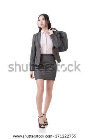 Confident Asian business woman hold a briefcase on shoulder, full length portrait isolated on white background.