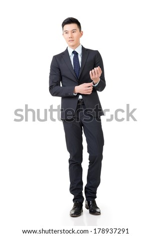 Confident Asian businessman, full length portrait isolated on white background.