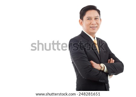 Confident Asian businessman smiling and looking at the camera
