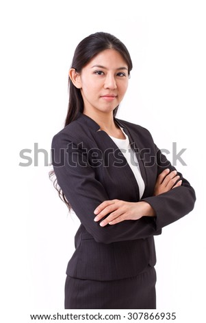 confident asian businesswoman crossing her arms - stock photo
