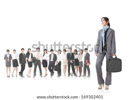Confident Asian businesswoman holding briefcase and stand in front of her team, full length portrait isolated on white background. - stock photo