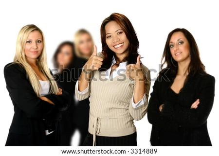 Confident Asian businesswoman with two female colleagues in the background. Concept of teamwork and professionalism.