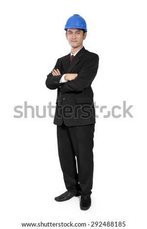 Confident Asian construction manager standing with crossed arms pose, full body shot, isolated on white background - stock photo