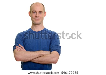 Confident bald Caucasian man with arms crossed isolated against white background
