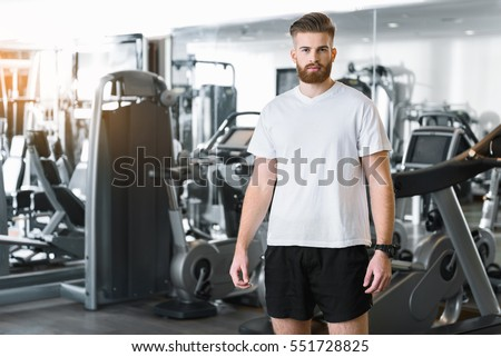 Confident bearded man in gym