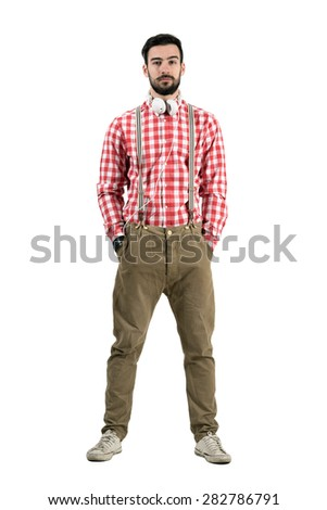Confident bearded young dj with earphones around his neck. Full body length portrait isolated over white background.
